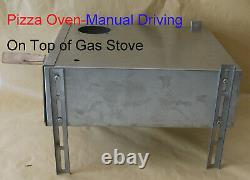 Portable pizza oven on top of gas stove